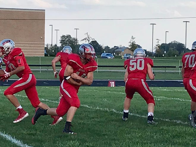 Elgin senior Danyal Minton (44) runs a fake during warmups before a football game in 2018. Minton and the Comets of 2017 and 2018 featured one of the most potent running attacks in state history.
