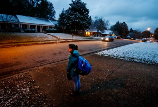 Collierville High School student Casey Hanauer, 16, waits for a school bus at 6:09 a.m. in her neighborhood Thursday morning. Some Collierville parents want school to start later, and the Collierville Schools district formed a committee to explore the possible benefits and impact a change in time would have on students, parents and employees.
