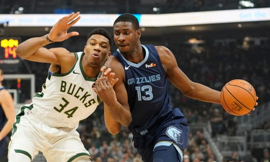 Memphis Grizzlies' Jaren Jackson Jr. tries to drive past Milwaukee Bucks' Giannis Antetokounmpo during the first half of an NBA basketball game Wednesday, Nov. 14, 2018, in Milwaukee. (AP Photo/Morry Gash)