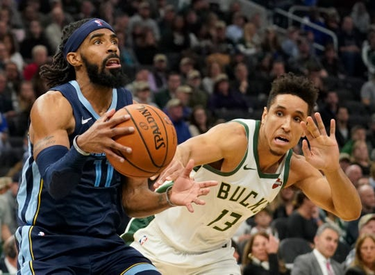 Memphis Grizzlies' Mike Conley drives past Milwaukee Bucks' Malcolm Brogdon during the first half of an NBA basketball game Wednesday, Nov. 14, 2018, in Milwaukee. (AP Photo/Morry Gash)