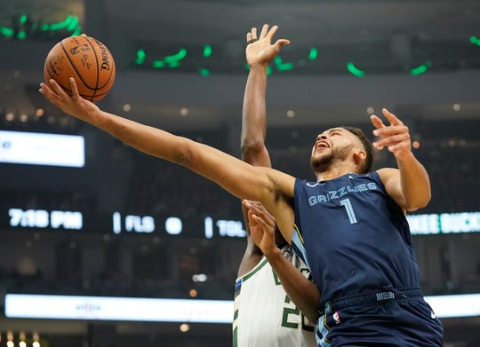 Memphis Grizzlies' Kyle Anderson shoots past Milwaukee Bucks' Khris Middleton during the first half of an NBA basketball game Wednesday, Nov. 14, 2018, in Milwaukee.