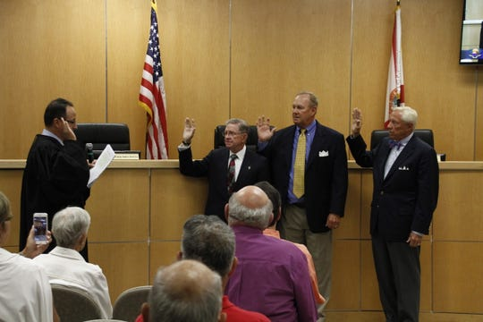 Victor Rios, Sam Young and Erik Brechnitz are sworn in Tuesday after winning election to the Marco Island City Council