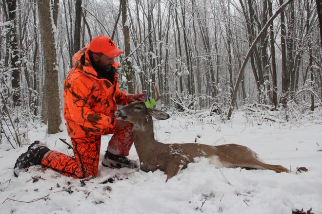 Outdoors editor Paul A. Smith tags a buck he shot in Germantown on opening day of the 2015 Wisconsin gun deer hunting season. Photo taken Nov. 21, 2015 by Paul A. Smith.