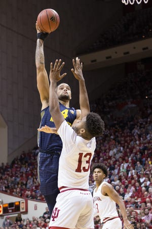 Golden Eagles forward Theo John throws up a hook shot over Indiana forward Juwan Morgan during the second half on Wednesday.