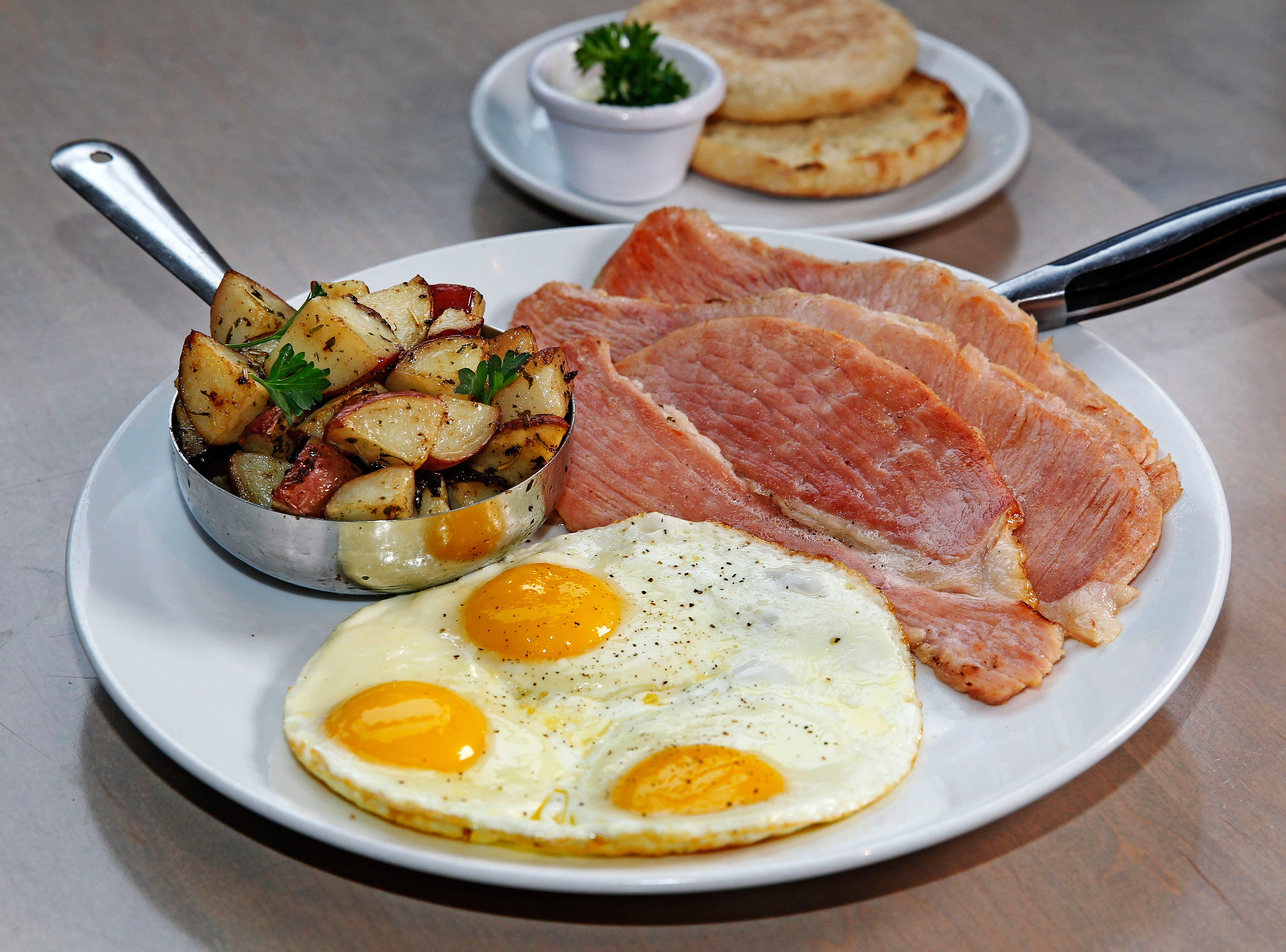 "Three eggs, breakfast potatoes and toast (or English muffin) are served with ham ""off the bone"" at Sweet Diner at 239 E. Chicago St. The restaurant serves brunch every day."