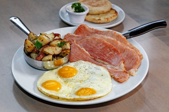 """Three eggs, breakfast potatoes and toast (or English muffin) are served with ham """"off the bone"""" at Sweet Diner at 239 E. Chicago St. The restaurant serves brunch every day."""