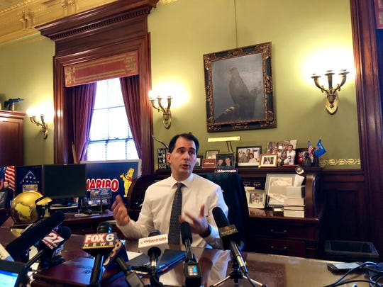 Gov. Scott Walker speaks to reporters for the first time since his Nov. 6 loss to Tony Evers.