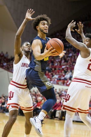Marquette guard Markus Howard splits a pair of Indiana defenders as he goes up for a shot down low on Wednesday night.