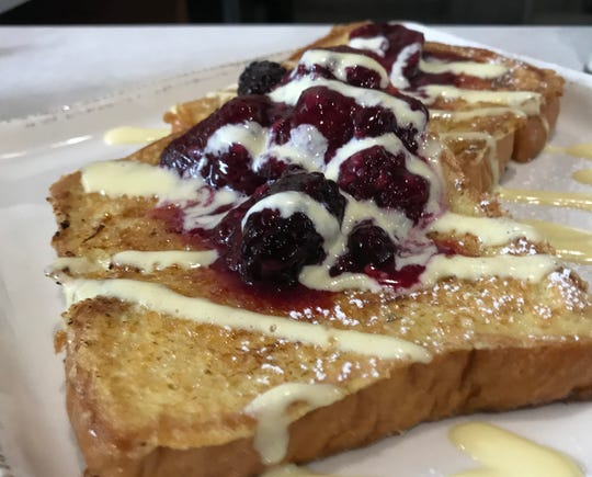 Creme brulee French toast is topped with macerated berries and creme anglaise at MidTown Grill, 8913 W. North Ave. in Wauwatosa. It serves breakfast and lunch items daily.
