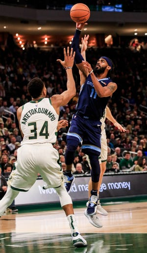 Grizzlies guard Mike Conley shoots over Giannis Antetokounmpo on Wednesday night. Conley finished with 26 points.