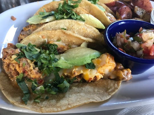 Chorizo-egg breakfast tacos are served with potatoes, pico de gallo and fruit at Fiesta Cafe, open daily for brunch at 1407 S. First St.
