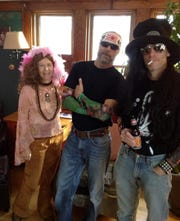 One year everyone came as rock stars. From left are Jeanne Miller as Janis Joplin, John Husz as Tom Petty and John's brother, Jerry, as Slash.