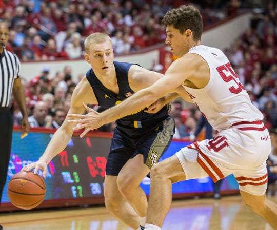 Marquette forward Joey Hauser drives against Indiana forward Evan Fitzner during the second half Wednesday night.