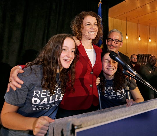 Rebecca Dallet trounced Michael Screnock for a seat on the Wisconsin Supreme Court. Dallet celebrated with her husband, Brad, and daughters  Rachel (left) and Ellie (right).