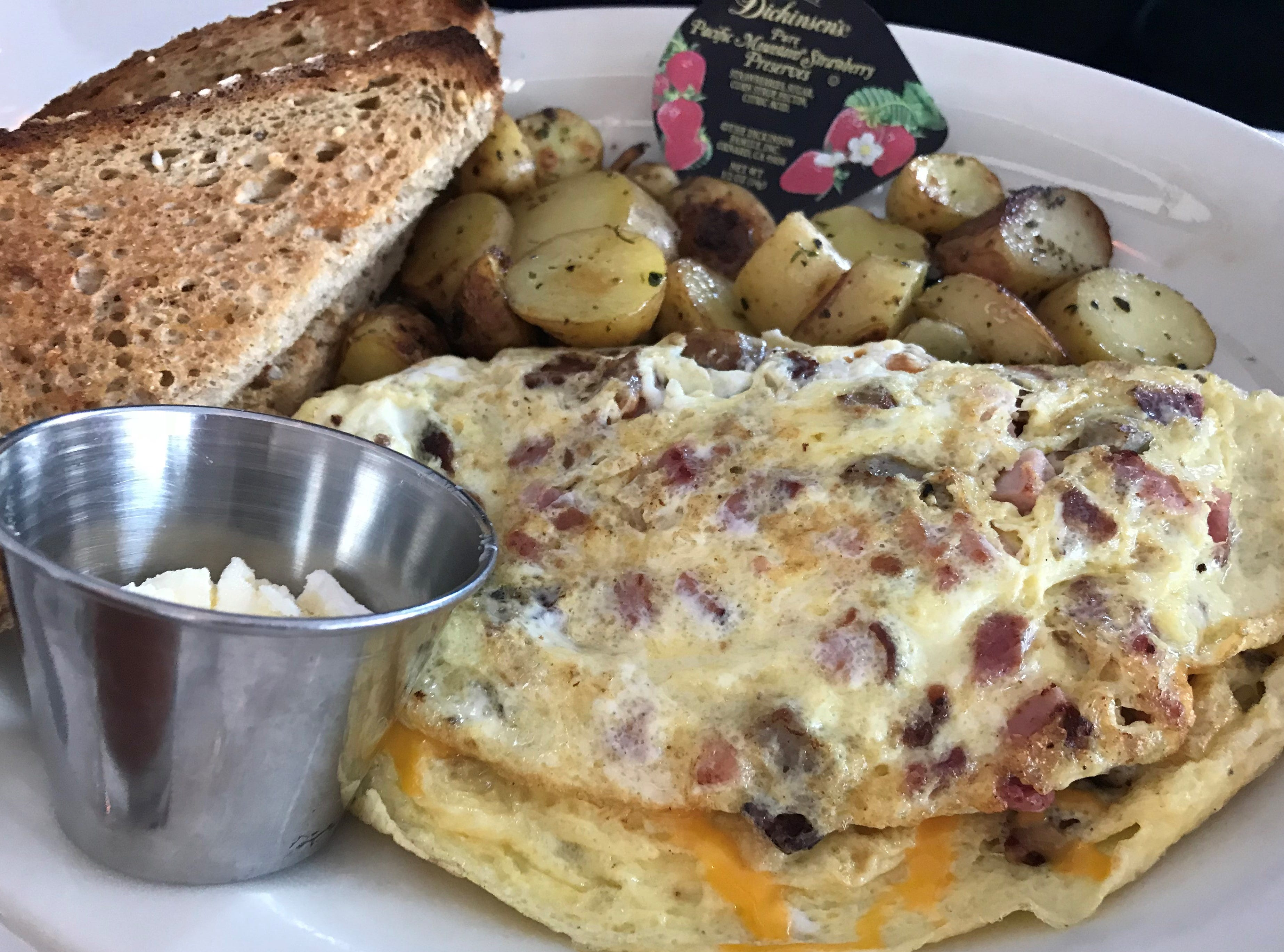Zisters, a brunch restaurant in Elm Grove, serves a three-meat omelet (bacon, sausage and ham) with cheddar, plus potatoes and toast on the side.