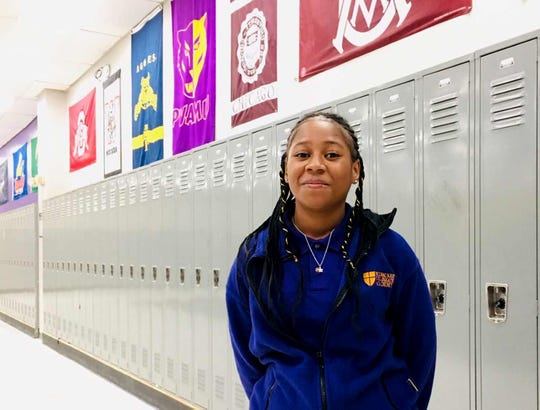 """Danajan Hightower, 16, a sophomore at the Milwaukee Collegiate Academy, recites the school's mission by heart: """"to nurture scholars capable of transforming their world by sending them to and through college."""" On the walls behind her are pennants and flags from colleges around the nation."""