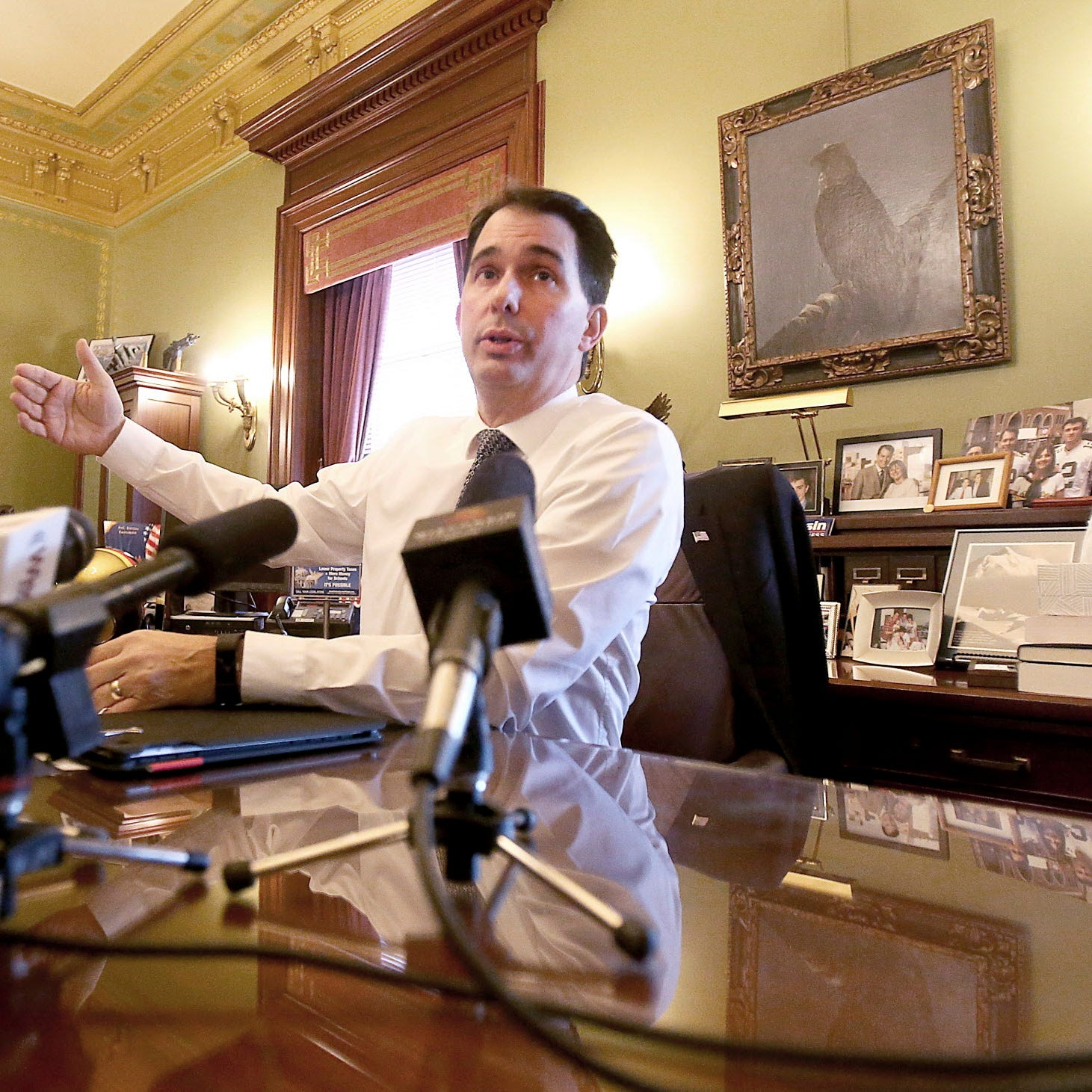 Scott Walker says he'll issue some vetoes even as he shows support for lame-duck bills