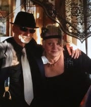 Doug Miller and Kathie Husz get their gangster on during a Thanksgiving celebration.