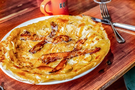 Slices of apple and bacon are cooked into the pannekoek, the thin, Dutch-style pancake new to the menu at Cafe Hollander. The restaurant has locations in Milwaukee, Wauwatosa, Brookfield, Mequon and Madison.