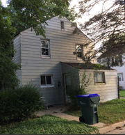 The siding would have to be removed on the home at 5597 Apple Court to get back to its original cinder block construction. The Greendale Historical Society wants to buy the vacant home and restore it to its 1938 appearance as an original Greenbelt home.