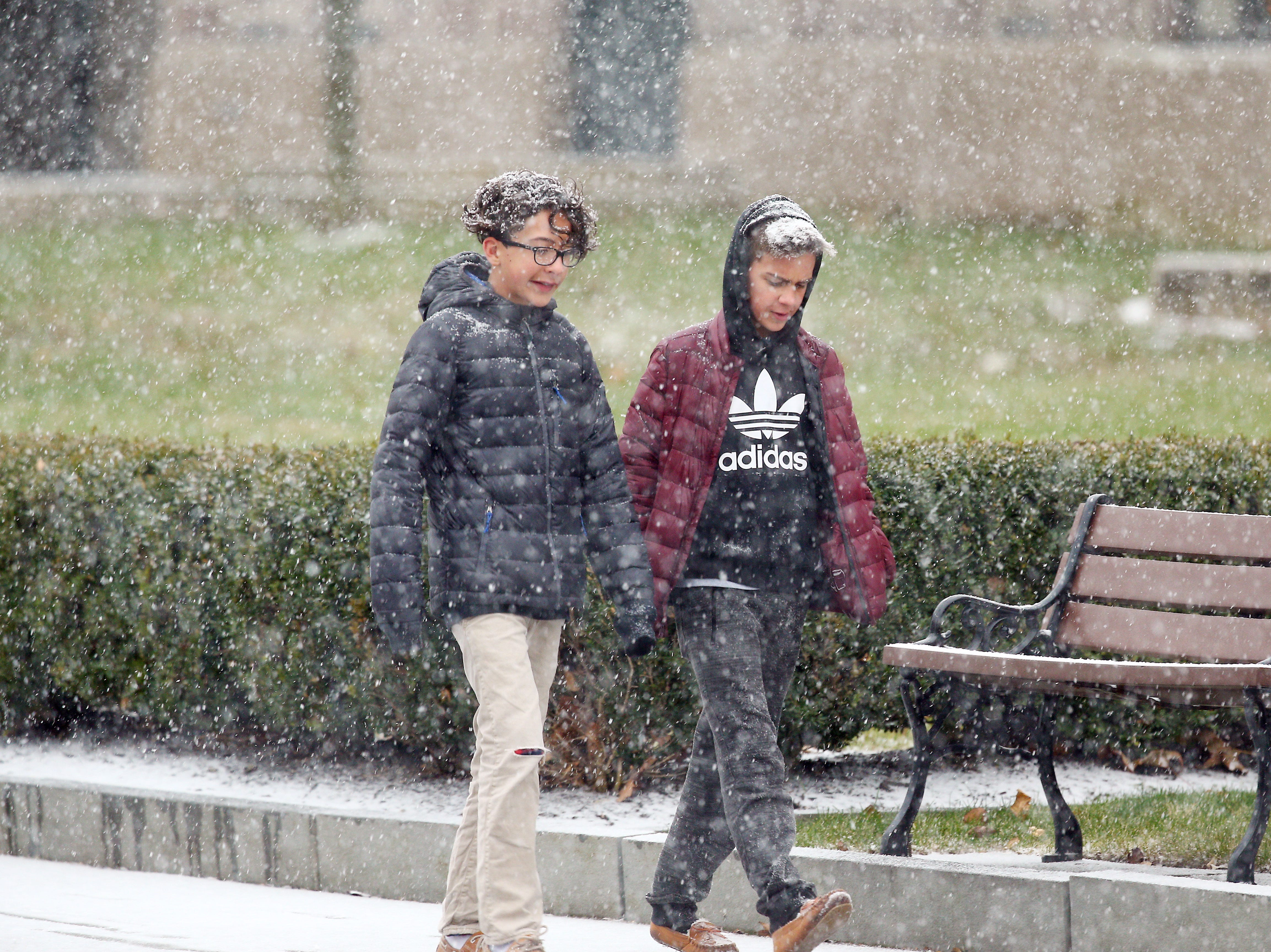 Pedestrians in Morristown navigate at the beginning of a predicted nor'easter, scheduled to dump over half a foot of snow and freezing rain on the area.  November 15, 2018, Morristown, NJ