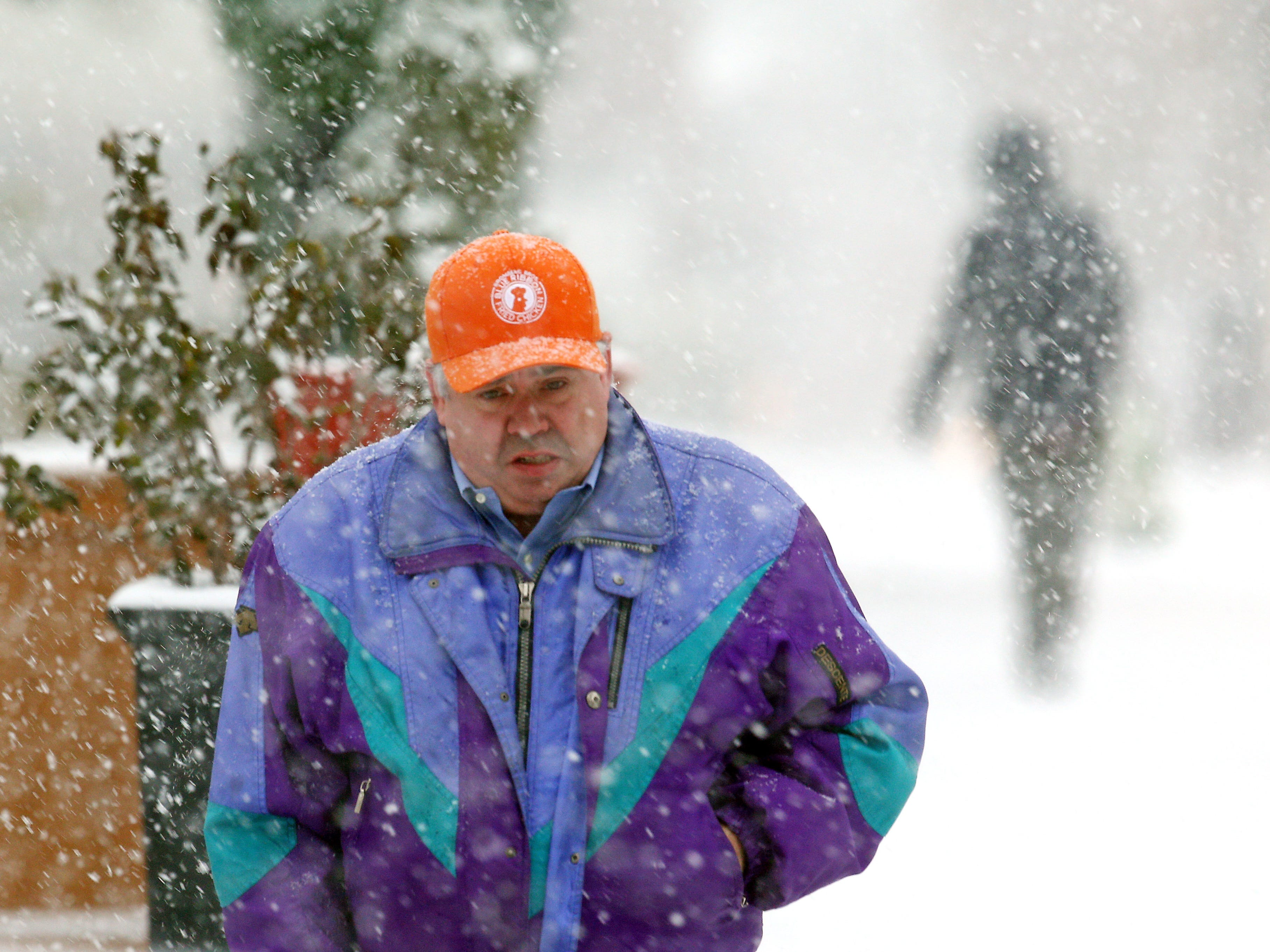 Snow starts to become heavier as pedestrians in Morristown navigate a predicted nor'easter, scheduled to dump over half a foot of snow and freezing rain on the area.  November 15, 2018, Morristown, NJ