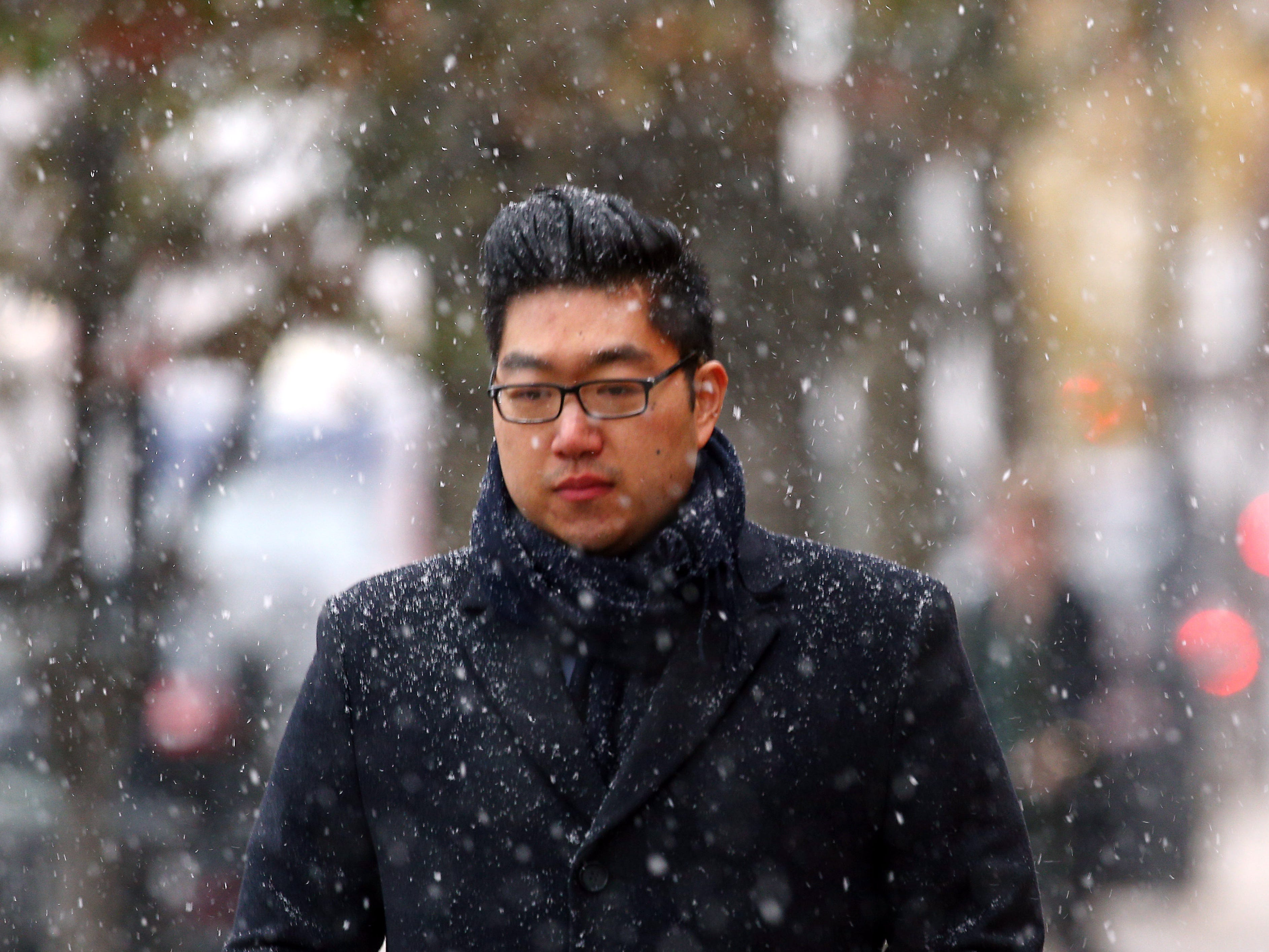 Allan Zhang of Morristown walks down South Street at the beginning of a predicted nor'easter, scheduled to dump over half a foot of snow and freezing rain on the area.  November 15, 2018, Morristown, NJ