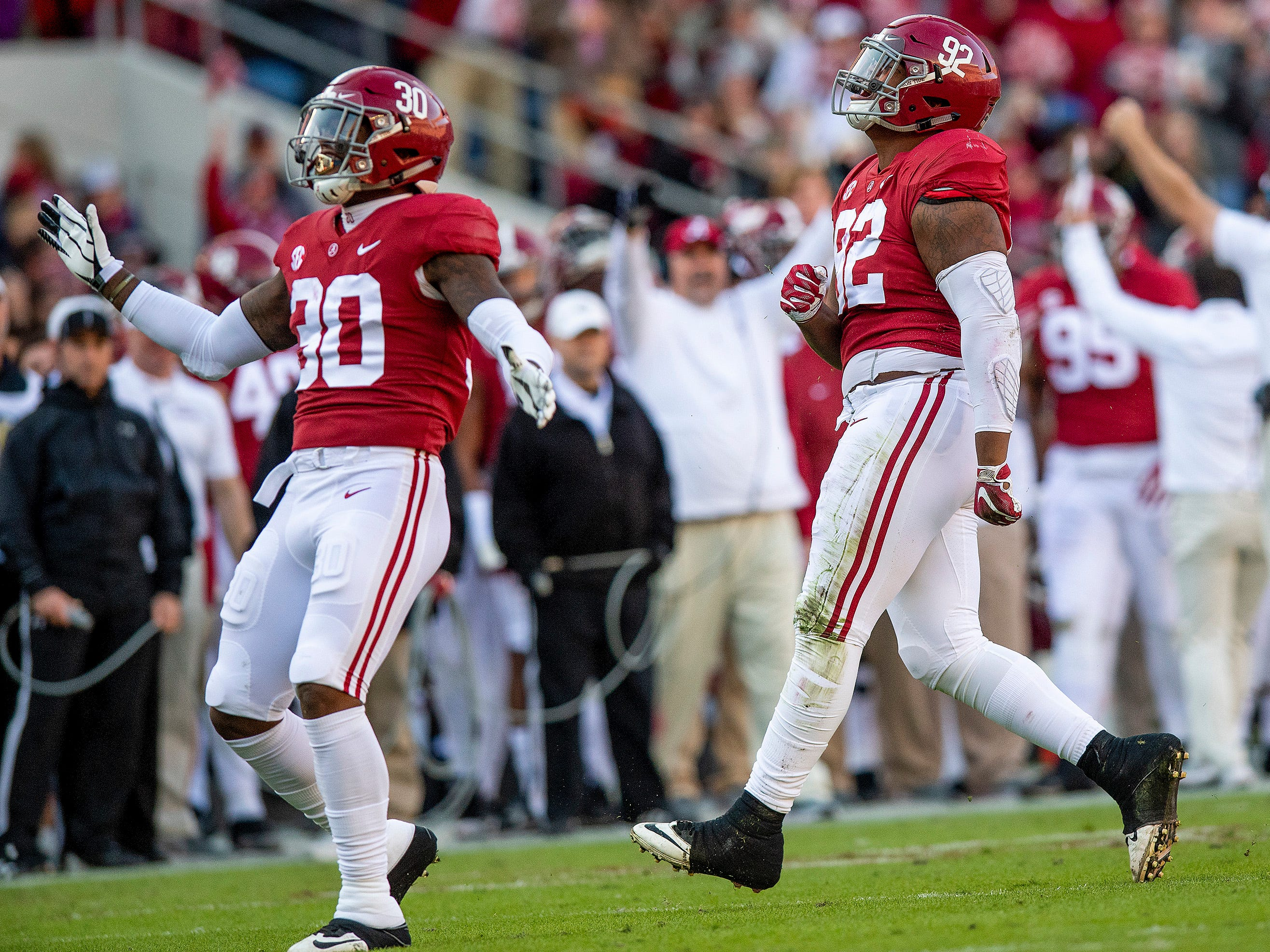 Alabama linebacker Mack Wilson (30) and Alabama defensive lineman Quinnen Williams (92) celebrate a sack against Mississippi State in first half action at Bryant Denny Stadium in Tuscaloosa, Ala., on Saturday November 9, 2018.