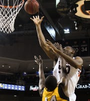 Auburn center Austin Wiley (50) shoots while defended by Mississippi College forward Isaiah Austin (44) on Wednesday, Nov. 14, 2018, in Auburn, Ala.