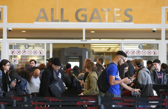 Travelers move through waiting lines at the international counter at Hartsfield-Jackson International Airport in Atlanta in this file photo.