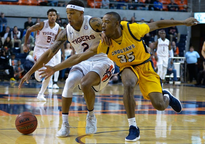 Auburn guard Bryce Brown (2) keeps the ball away from Mississippi College guard Dyllan Taylor (35) on Wednesday, Nov. 14, 2018, in Auburn, Ala.