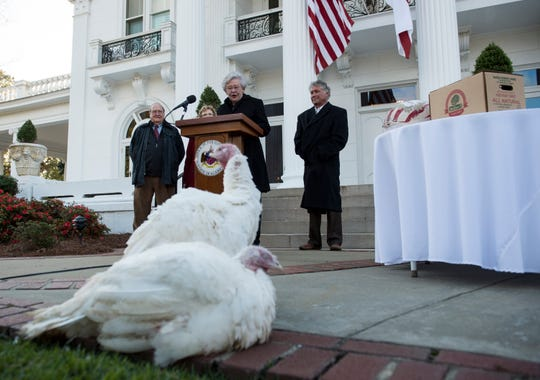 Alabama Gov. Kay Ivey pardons turkeys, Henrietta and Clyde, during the annual turkey pardon outside the governor's mansion in Montgomery, Ala., on Thursday, Nov. 15, 2018.
