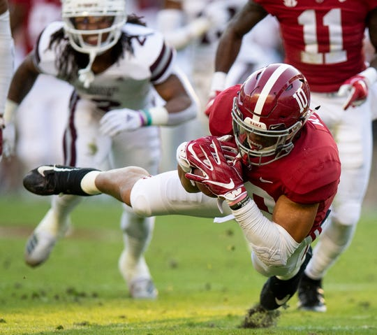 Alabama linebacker Ale Kaho (10) recovers a fumble punt return by Mississippi State University in first half action at Bryant Denny Stadium in Tuscaloosa, Ala., on Saturday November 9, 2018.