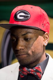 Jaykwon Walton wears a Georgia bow tie and hat during signing day at Carver High School in Montgomery, Ala., on Thursday, Nov. 15, 2018.