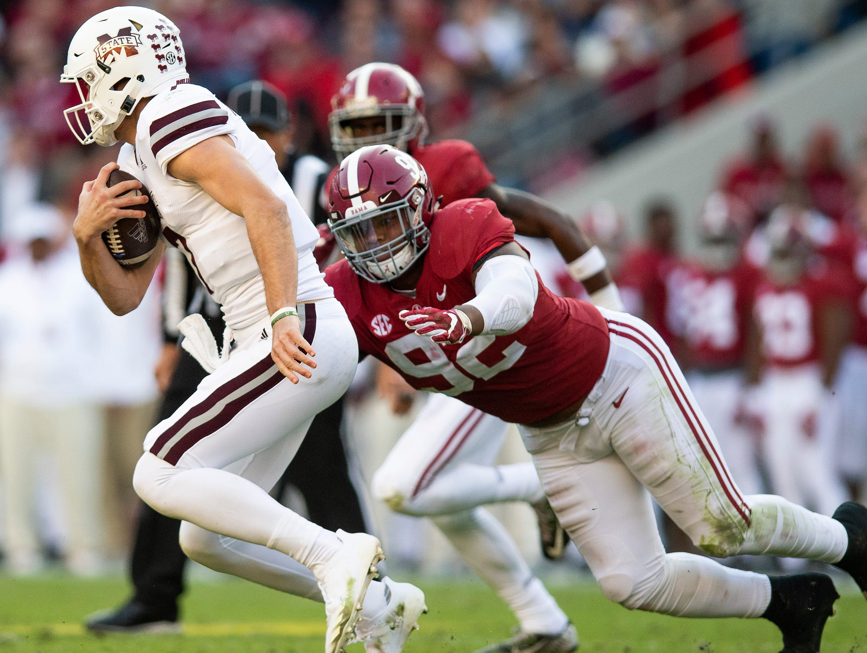 Alabama defensive lineman Quinnen Williams (92) tackles Mississippi State quarterback Nick Fitzgerald (7) in first half action at Bryant Denny Stadium in Tuscaloosa, Ala., on Saturday November 9, 2018.