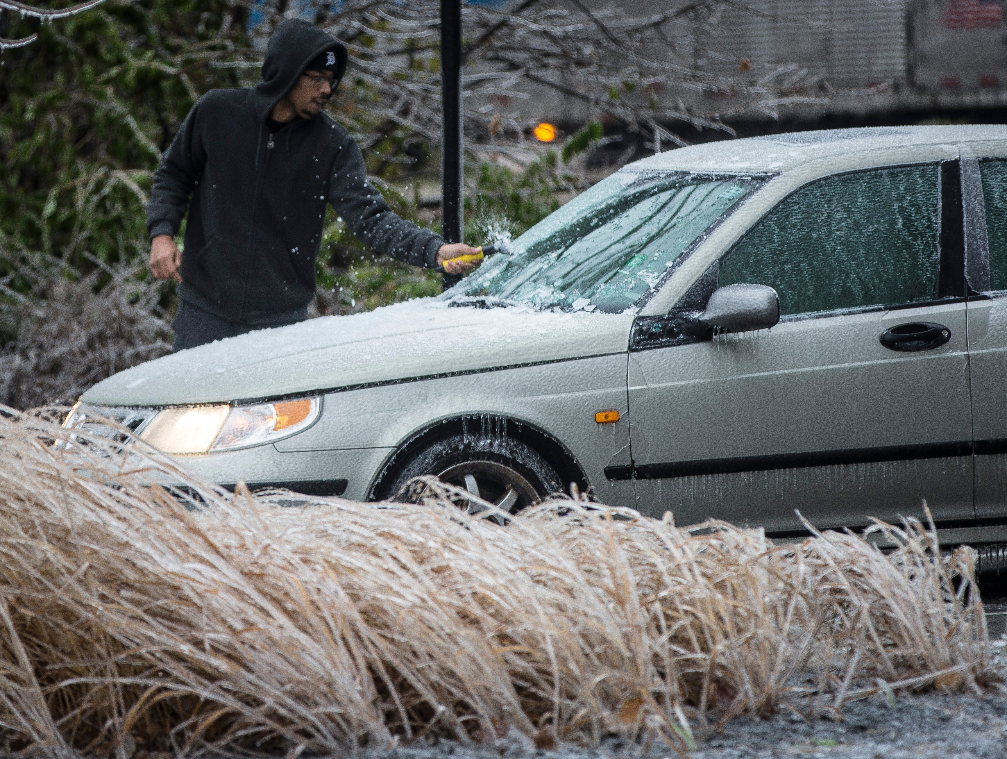 Ice from overnight sleet blankets road signs, cars and more causing travel advisories, school cancellations and even power outages.