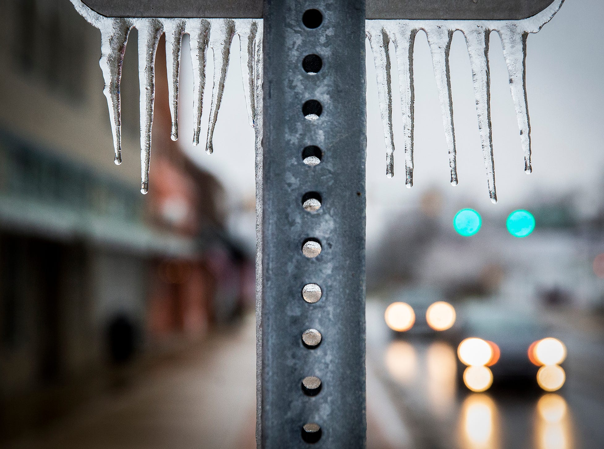 Icicles form in downtown Yorktown after storms early Thursday.