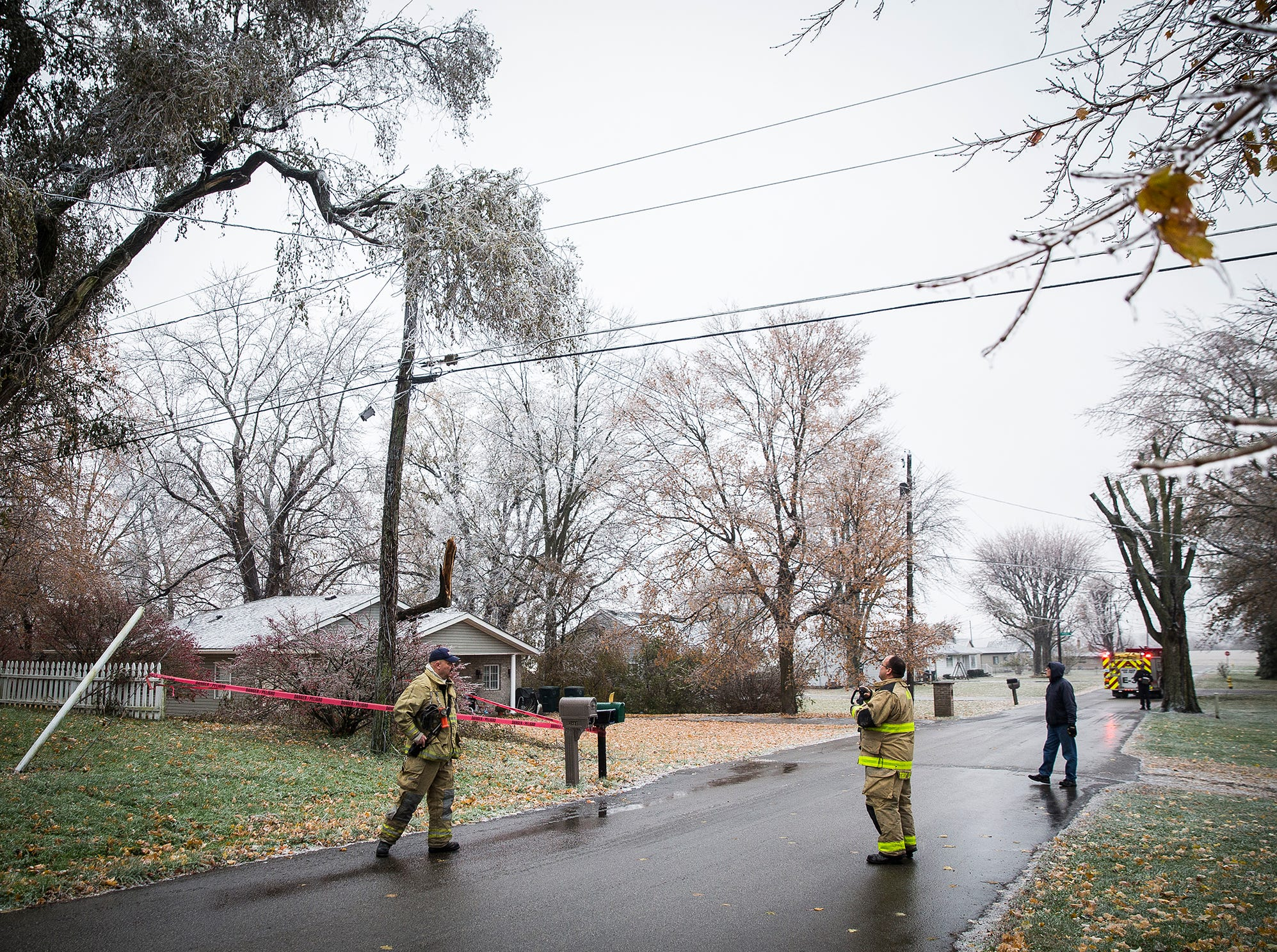 Firefighters respond to a downed power line call after ice storms hit Delaware County Thursday morning.