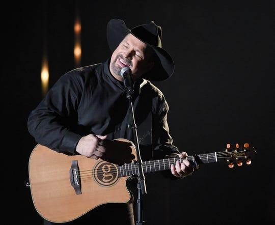 Garth Brooks performs during the 52nd Annual CMA Awards at Bridgestone Arena Wednesday Nov. 14, 2018, in Nashville, Tenn.