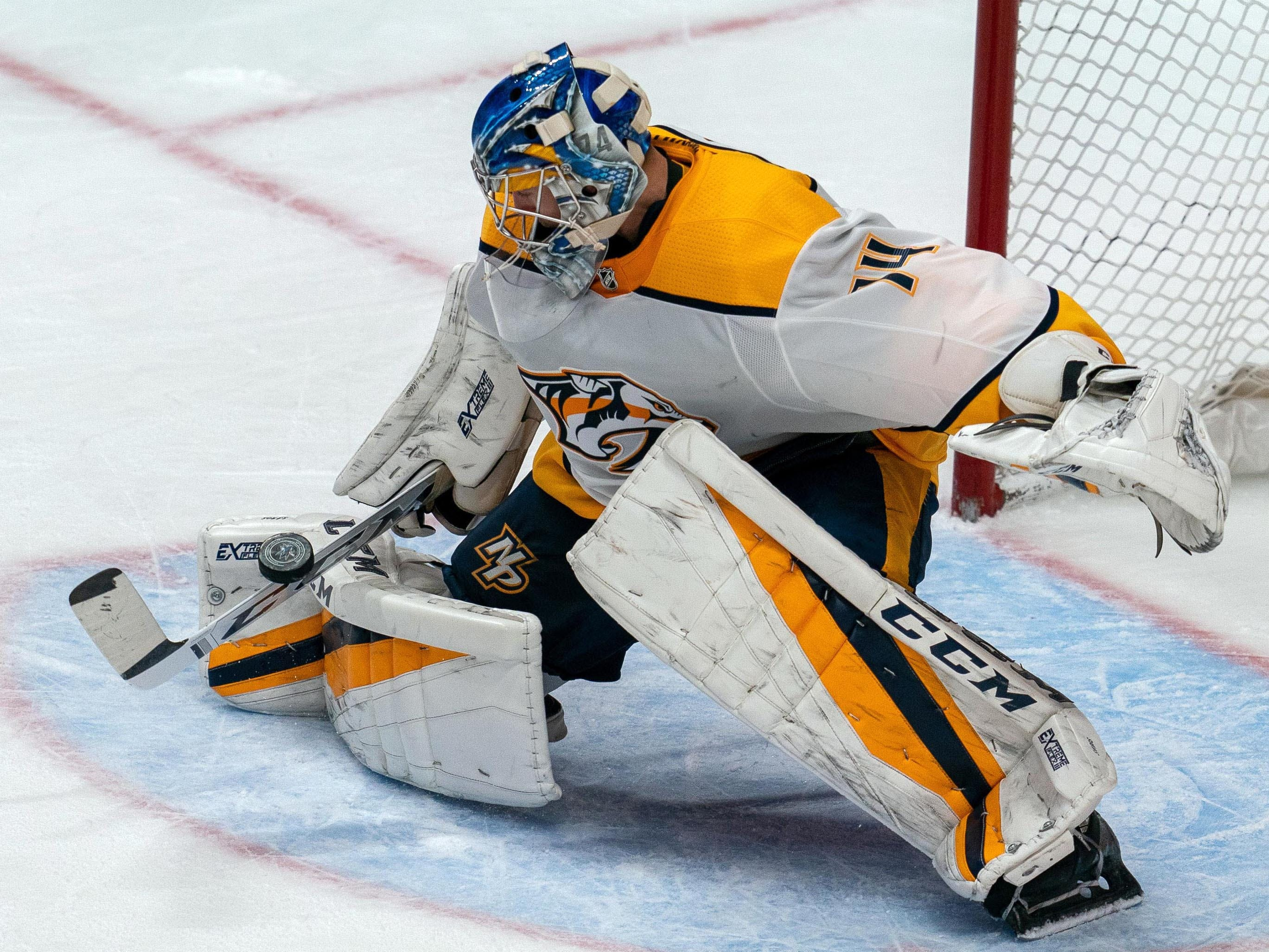 Nashville Predators goaltender Juuse Saros (74) makes a save during the third period against the San Jose Sharks at SAP Center at San Jose.
