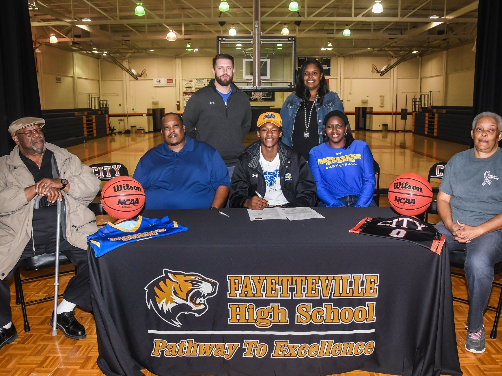 Fayetteville's Julius Dixon signed with Morehead State to play basketball.