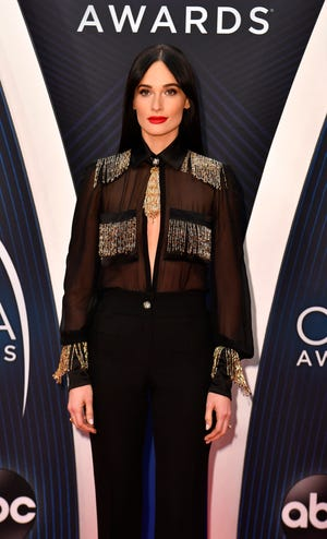 Kacey Musgraves  walks the red carpet before the 52nd annual CMA Awards on Wednesday at Bridgestone Arena.