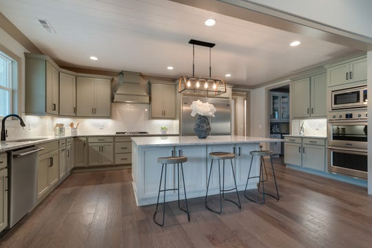 This kitchen in a home for sale in McDaniel Farms shows how rooms can be larger and more spacious in a one-story floorplan built on a larger lot.