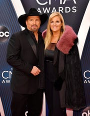 Garth Brooks and Trisha Yearwood walk the red carpet before the 52nd annual CMA Awards on Nov. 14, 2018, at Bridgestone Arena in Nashville.