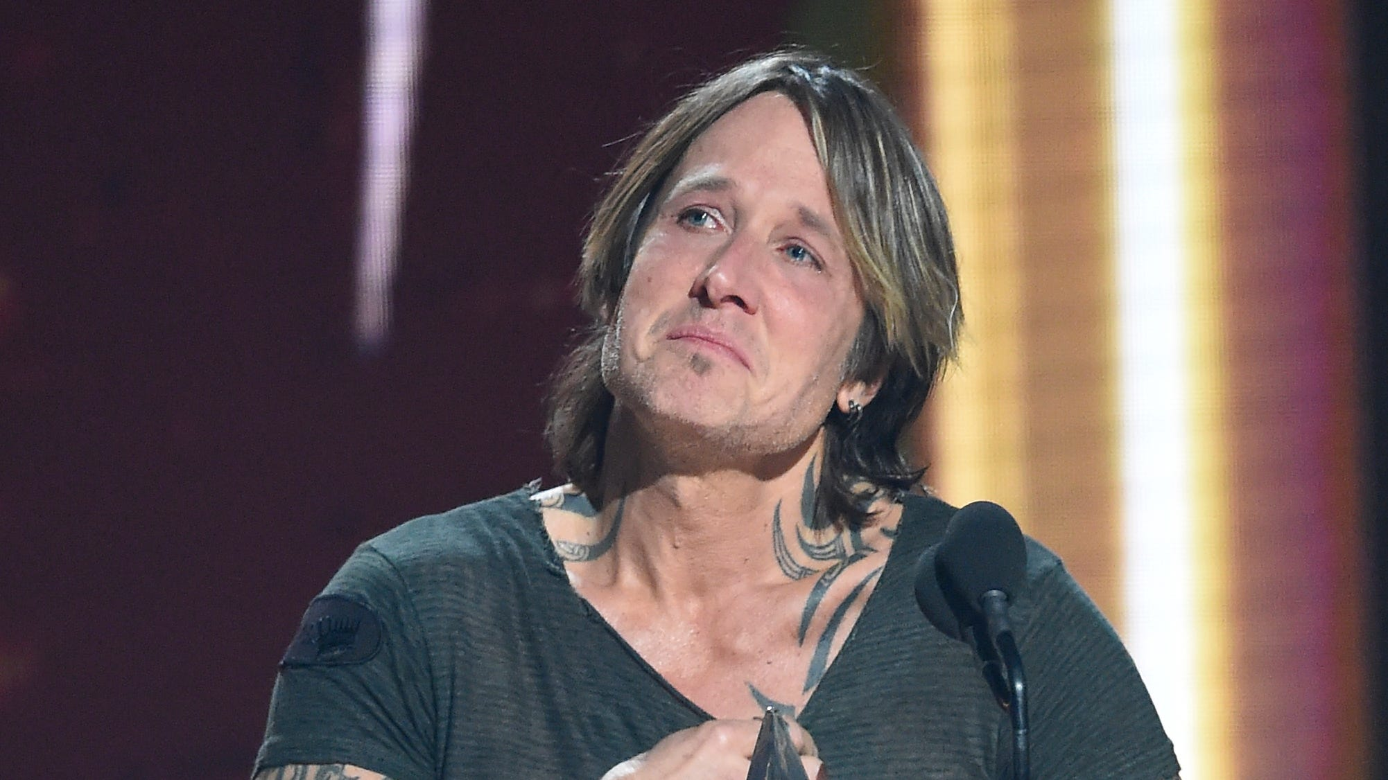 Keith Urban gets emotional as he accepts the Entertainer of the Year award during the 52nd Annual CMA Awards at Bridgestone Arena Wednesday Nov. 14, 2018, in Nashville, Tenn.