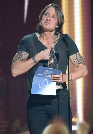 Keith Urban gets emotional as he accepts the Entertainer of the Year award during the 52nd Annual CMA Awards at Bridgestone Arena on Wednesday in Nashville.