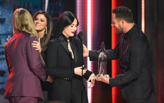 """Kacey Musgraves accepts the award for Best Album of the Year for """"Golden Hour"""" from Little Big Town during the 52nd Annual CMA Awards at Bridgestone Arena Wednesday Nov. 14, 2018, in Nashville, Tenn."""