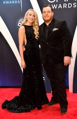 Luke Combs and his fiancee, Nicole Hocking, walk the red carpet before the 52nd annual CMA Awards on Nov. 14, 2018, at Bridgestone Arena in Nashville.