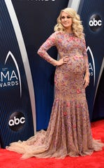 Host Carrie Underwood on the red carpet before the 52nd Annual CMA Awards at Bridgestone Arena Wednesday, Nov. 14, 2018, in Nashville, Tenn.