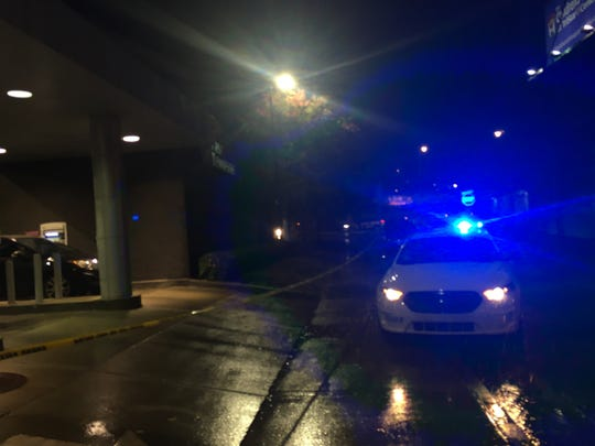 A police car sits near a bank ATM at First Tennessee Bank in the West End, where a woman was shot in the leg during a robbery Wednesday afternoon. She was transported to Vanderbilt University Medical Center with non-life-threatening injuries, police say.